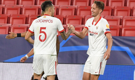 Ocampos and De Jong celebrate the striker's goal