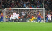 Javi Varas saving a penaly from Leo Messi